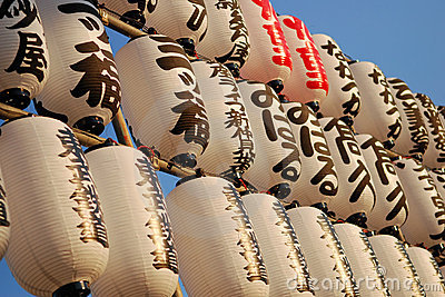 Rows of Japanese paper lanterns at sunset