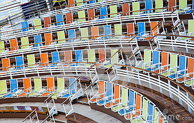 Rows of Orange Blue and Yellow Chairs