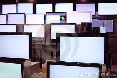 Rows of plasma TVs stand on shelves Editorial Stock Photo