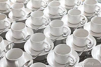 Rows of pure cup and saucer with teaspoon
