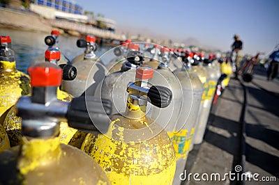 Rows of scuba tanks