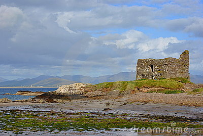 Rruins of castle on the beach. Ireland