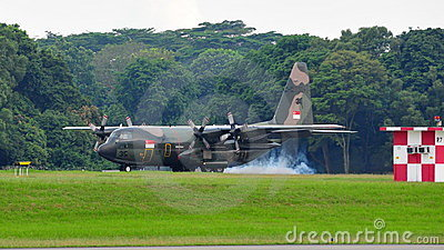 RSAF C-130 military transport plane landing Editorial Photo