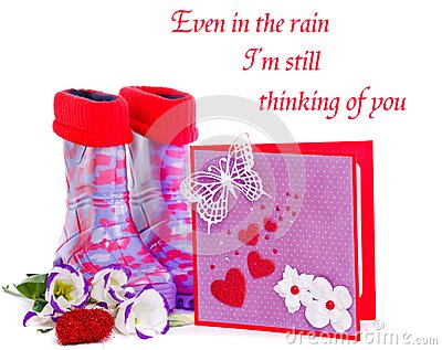 Rubber boots and greeting card