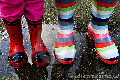 Rubber boots in a rain puddle