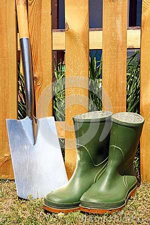 Rubber boots and spade