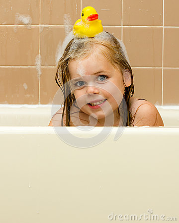 Free Rubber Ducky On Her Head Stock Photography - 30524832