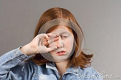 Rubbing eyes drowsy person