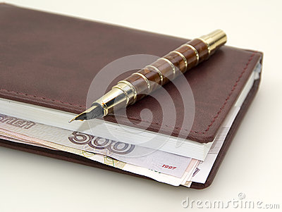 Money inside the diary, and pen