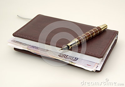 Ruble money inside the diary, and pen