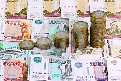 10 rubles coins on banknote money background