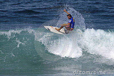 Rudy Palmboom surfing in the Triple Crown Hawaii Editorial Stock Image