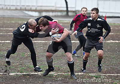Rugby players in action Editorial Stock Image