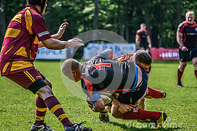Rugby players falling down Editorial Photo