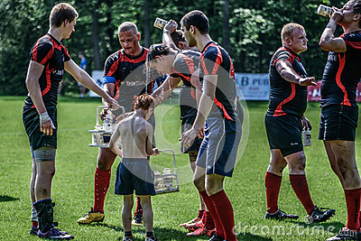 Rugby players having a break Editorial Stock Image