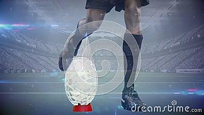 Rugbyspeler het schoppen voetbal met geanimeerde glasscherven die van de bal in volledig stadion komen stock video