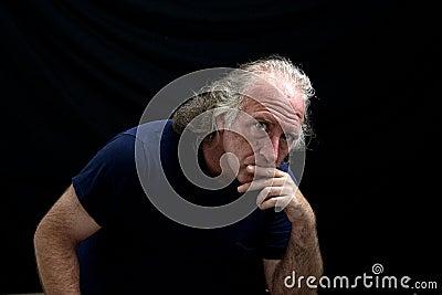 Rugged looking man staring at viewer