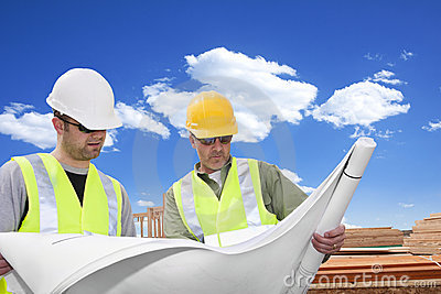 Rugged Male Architects looking at a blueprint