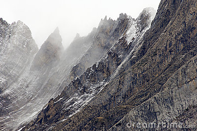 Rugged mountains in the winter fog