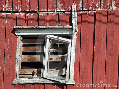 Ruined old wooden house window