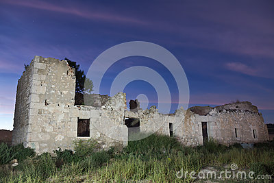 Ruins of an abandoned house at night