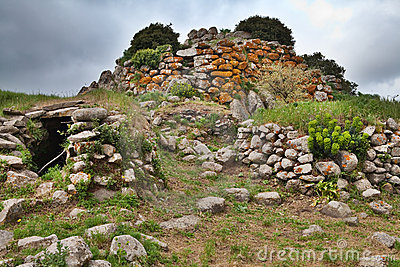 Ruins of ancient culture Sardinia Nuraghe tower
