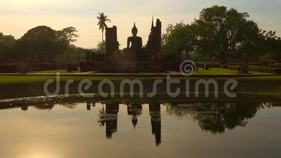 The ruins of the Buddhist temple Wat Chana Songkram at sunset. Sukhothai, Thailand. The ruins of the Buddhist temple Wat Chana Songkram at sunset. Historical stock footage