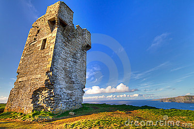 Ruins of old castle on irish Cliffs of Moher