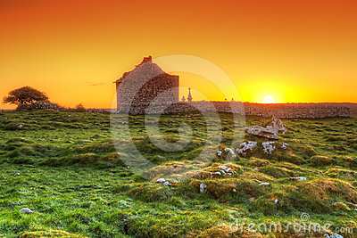 Ruins of old Irish chapel at sunrise