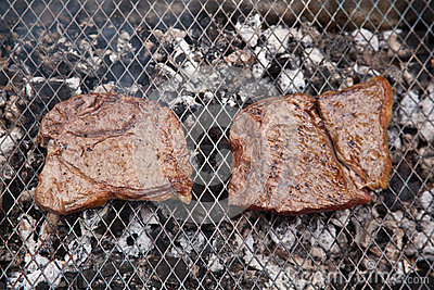 Rump steaks on barbecue