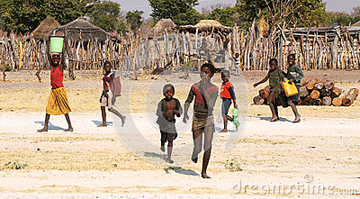 RUNDU, NAMIBIA - SEPTEMBER 19: Unidentified children fetching wa Editorial Photo