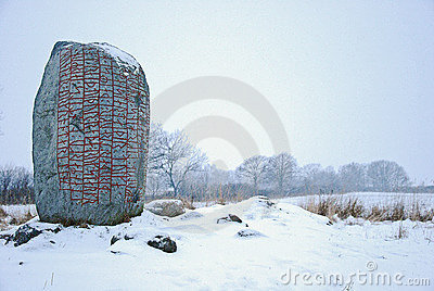 Rune-stone in winter landscape