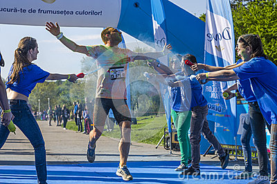 Runner covered with blue powder Editorial Photography