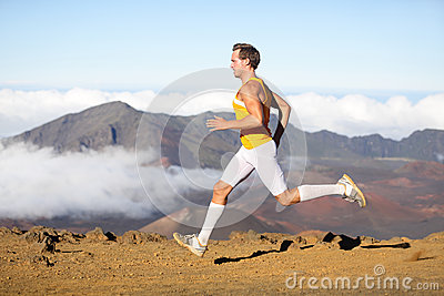 Runner man athlete running sprinting fast male sport fitness model