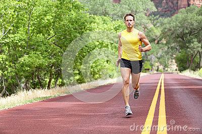 Runner man running on road