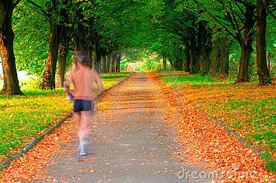 Runner in motion in a beautiful park