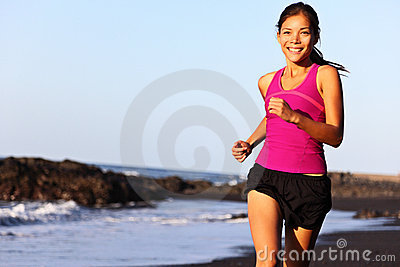 Runner running on beach