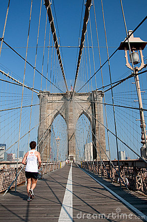 Runner running though Brooklyn Bridge