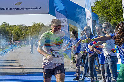 Runner showered with blue powder Editorial Stock Image