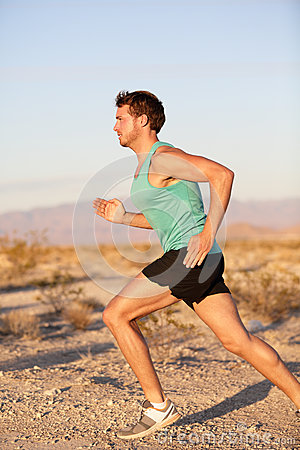 Runner sport man running and sprinting outside