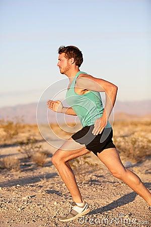 Runner sport man running and sprinting outside