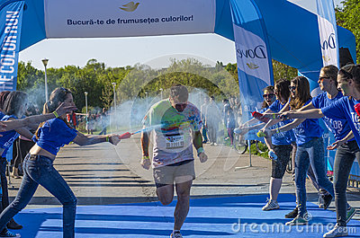 Runner sprayed with blue powder Editorial Image