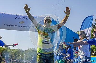 Runner sprayed with blue powder Editorial Photo