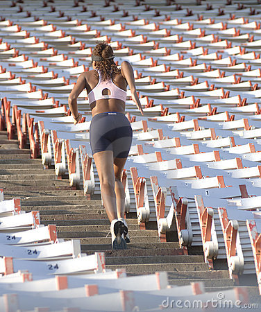 Runner on stadium stairs