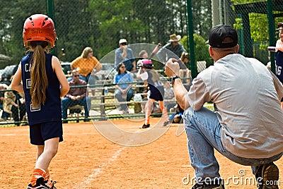Runner At Third/Girls Softball Editorial Stock Photo