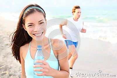 Runner woman drinking