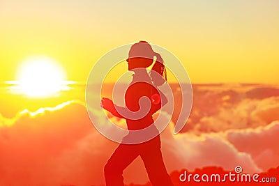 Runner woman running in sunshine sunset