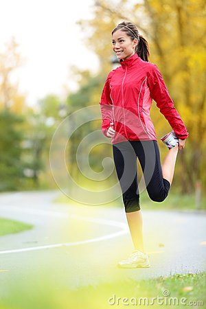 Runner woman stretching thigh