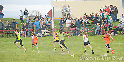 Runners in a track event at Nairn. Editorial Stock Image
