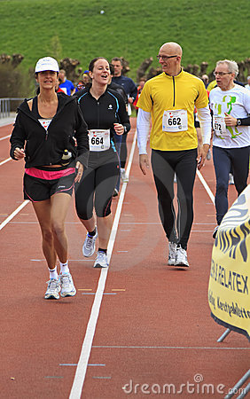 Runners warming up on the track before the race Editorial Image